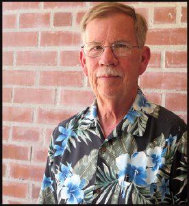 photo of Gary Gardner in Hawaian shirt in front of a brick wall