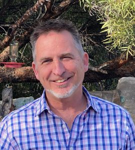 photo of Keith Ashley, who chairs Senior Pride's public relations/development committee in addition to his full-time job as Development Director of Tucson Audubon Society