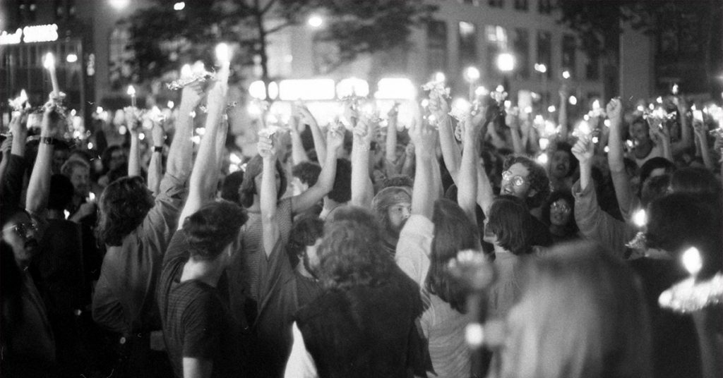 Many young people raising burning lighters. Photo credit: GREY VILLET / THE LIFE PICTURE COLLECTION / GETTY IMAGES